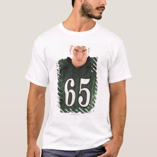 Teen football player holding helmet, portrait T-Shirt