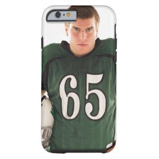 Teen football player holding helmet, portrait tough iPhone 6 case
