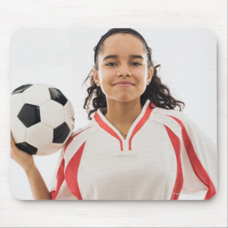 Teen girl holding soccer ball in hand, portrait mouse pad