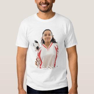 Teen girl holding soccer ball in hand, portrait t-shirt