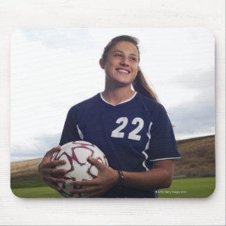 teen girl soccer player holding soccer ball mouse pad