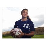 teen girl soccer player holding soccer ball postcard
