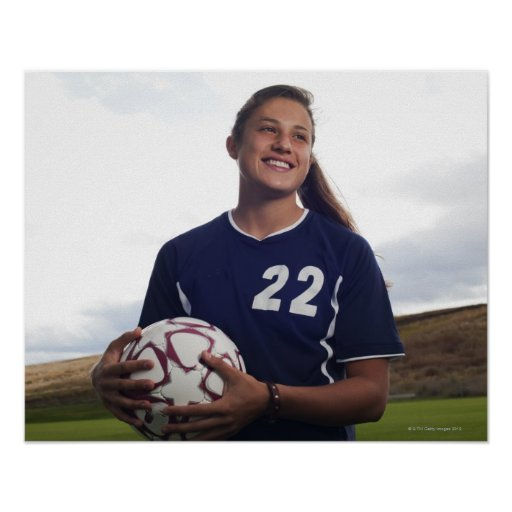 teen girl soccer player holding soccer ball poster