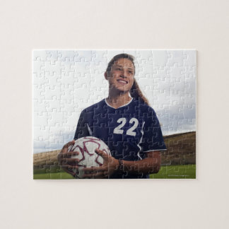 teen girl soccer player holding soccer ball puzzle
