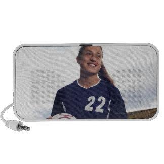 teen girl soccer player holding soccer ball travelling speakers