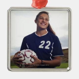 teen girl soccer player holding soccer ball square metal christmas ornament
