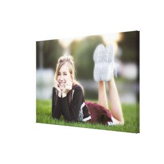 Teen relaxing on grass canvas print