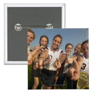Teenage (16-17) lacrosse team signalling number pin