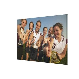 Teenage (16-17) lacrosse team signalling number canvas prints