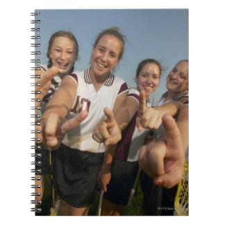 Teenage (16-17) lacrosse team signalling number spiral note book