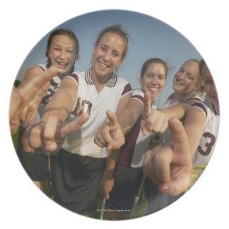 Teenage (16-17) lacrosse team signalling number dinner plates