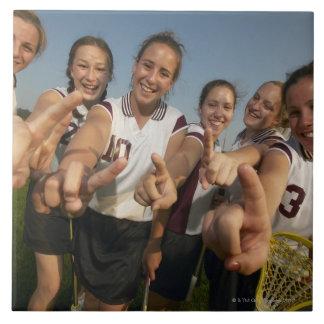 Teenage (16-17) lacrosse team signalling number ceramic tile