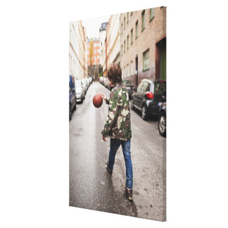 Teenage boy dribbling basketball canvas print