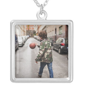 Teenage boy dribbling basketball square pendant necklace