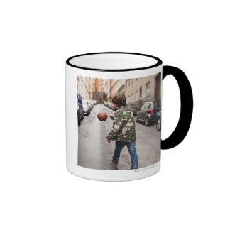 Teenage boy dribbling basketball ringer mug