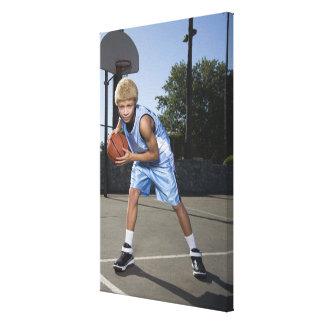 Teenage boy on basketball court 2 canvas print