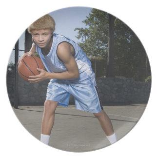 Teenage boy on basketball court 2 melamine plate