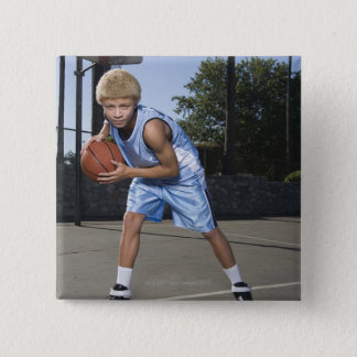 Teenage boy on basketball court 2 pinback button