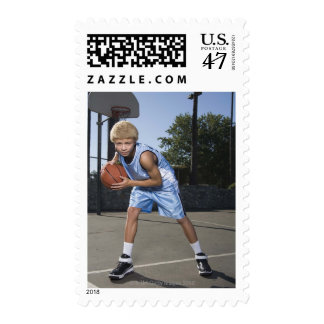 Teenage boy on basketball court 2 postage