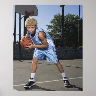 Teenage boy on basketball court 2 poster