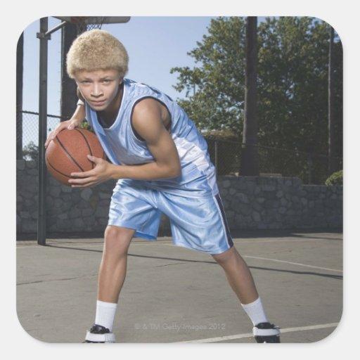 Teenage boy on basketball court 2 square sticker