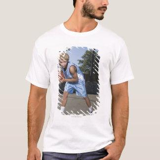 Teenage boy on basketball court 2 T-Shirt