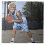 Teenage boy on basketball court 2 large square tile