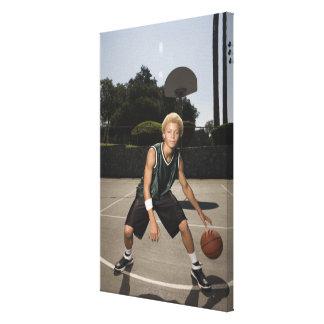 Teenage boy on basketball court canvas print
