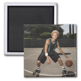 Teenage boy on basketball court magnet