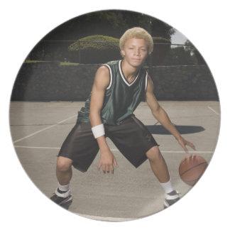 Teenage boy on basketball court melamine plate