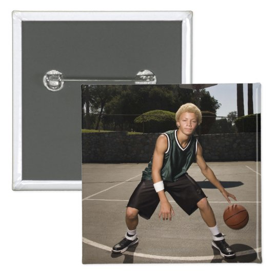 Teenage boy on basketball court pinback button