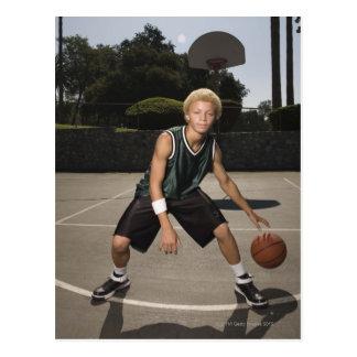 Teenage boy on basketball court postcard