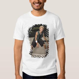 Teenage boy on basketball court shirt