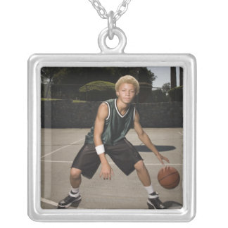 Teenage boy on basketball court silver plated necklace