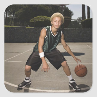 Teenage boy on basketball court square sticker