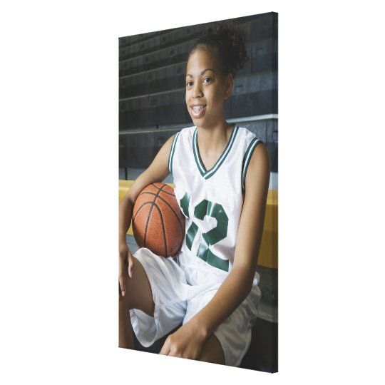 Teenage girl (13-15) wearing basketball uniform, canvas print
