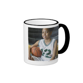 Teenage girl (13-15) wearing basketball uniform, ringer coffee mug