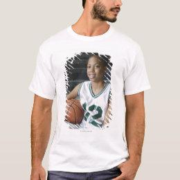 Teenage girl (13-15) wearing basketball uniform, T-Shirt