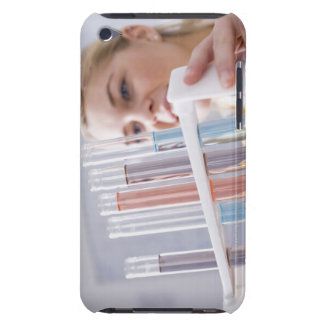 Teenage girl holding rack of test tubes iPod touch case