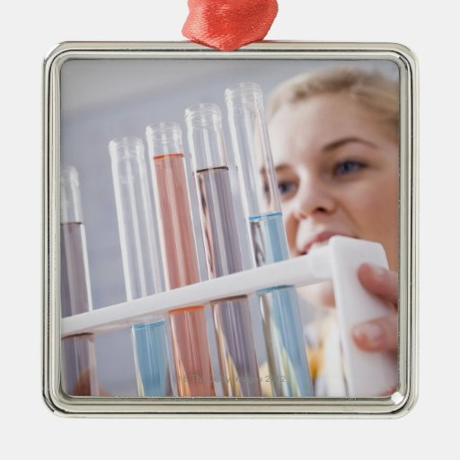 Teenage girl holding rack of test tubes square metal christmas ornament