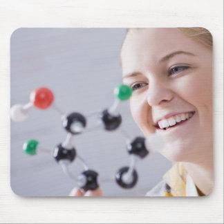 Teenage girl looking at molecule model mouse pad