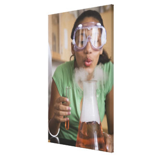 Teenage girl performing science experiment canvas print