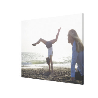 Teenage girl performs gymnastic feat, mom canvas print