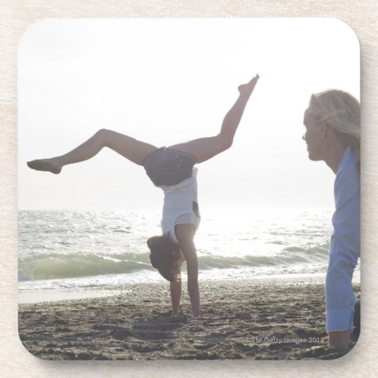 Teenage girl performs gymnastic feat, mom drink coaster