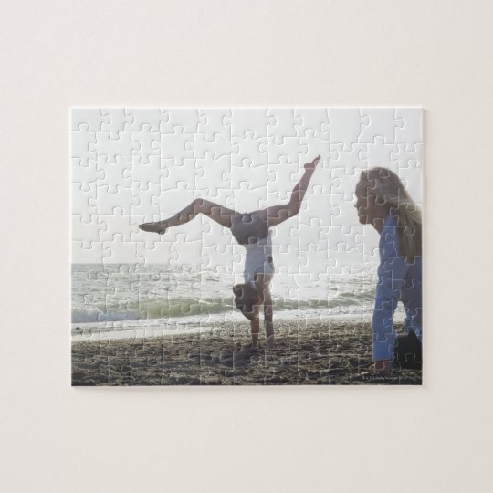 Teenage girl performs gymnastic feat, mom jigsaw puzzle