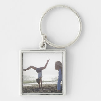 Teenage girl performs gymnastic feat, mom keychain