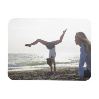 Teenage girl performs gymnastic feat, mom magnet