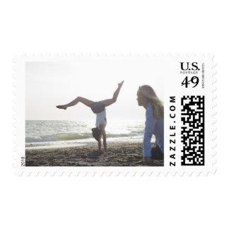 Teenage girl performs gymnastic feat, mom postage