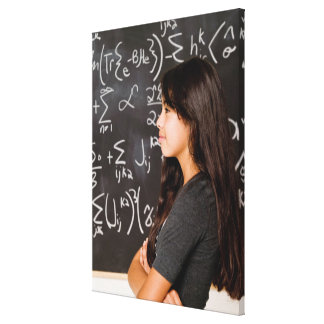 Teenage girl student at blackboard with math canvas print