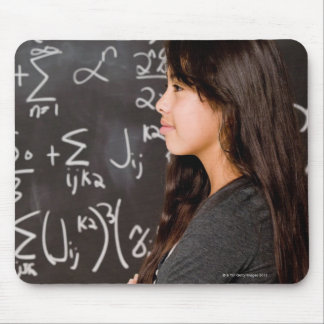 Teenage girl student at blackboard with math mouse pad